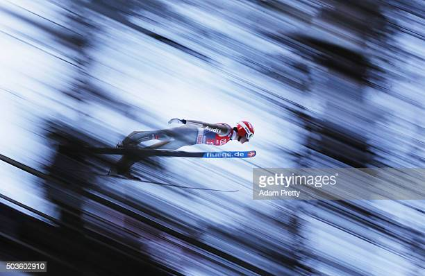 Richard Freitag of Germany soars through the air during his practice jump on day 2 of the 64th Four Hills Tournament in Bischofshofen on January 6...