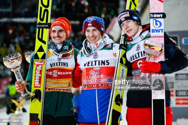 Richard Freitag of Germany takes 2nd place Kamil Stoch of Poland takes 1st place Dawid Kubacki of Poland takes 3rd place during the FIS Nordic World...