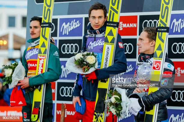 Richard Freitag of Germany takes 2nd place Kamil Stoch of Poland takes 1st place Anders Fannemel of Norway takes 3rd place during the FIS Nordic...