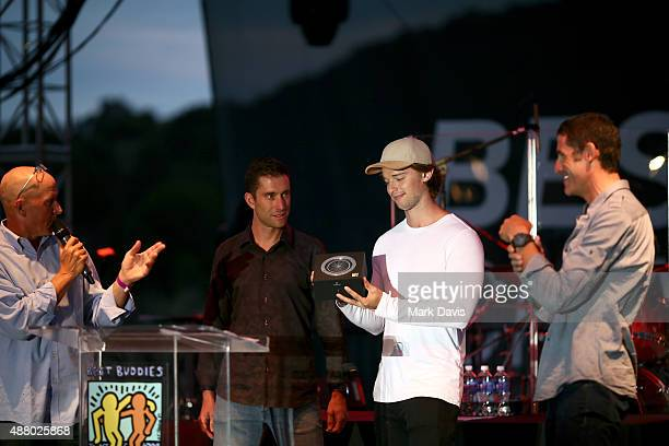 Richard Fries professional cyclist Christian Vande Velde actor Patrick Schwarzenegger and professional cyclist George Hincapie speak onstage at the...