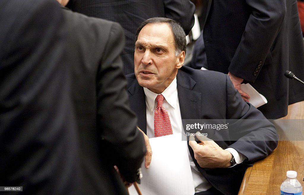 Richard Fuld, former chairman and chief executive officer of Lehman Brothers Holdings Inc., talks to an attendee of a House Financial Services Committee hearing on the Lehman Brothers bankruptcy in Washington, D.C., U.S., on Tuesday, April 20, 2010. Lehman, which filed the biggest bankruptcy in U.S. history, violated its own risk-management rules with the knowledge of the U.S. Securities and Exchange Commission, a bankruptcy examiner said. Photographer: Andrew Harrer/Bloomberg via Getty Images