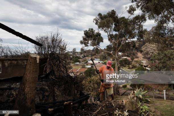 Richard Galton works to repair bushfire damage in the backayrd of his Tathra home on March 24 2018 in Tathra Australia Ricard stayed to defend his...