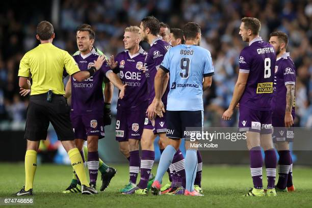 Richard Garcia Andy Keogh and Dino Djulbic of the Glory make their point to referee Peter Green during the ALeague Semi Final match between Sydney FC...