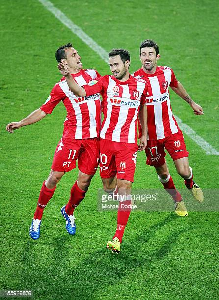 Richard Garcia Josip Tadic and Jason Hoffman of the Heart celebrate a Tadic penalty goal during the round six ALeague match between the Melbourne...