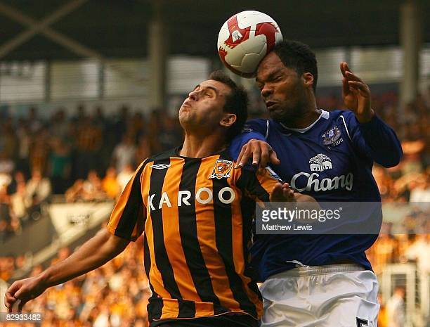 Richard Garcia of Hull and Joleon Lescott of Everton challenge for the ball during the Barclays Premier League match between Hull City and Everton at...