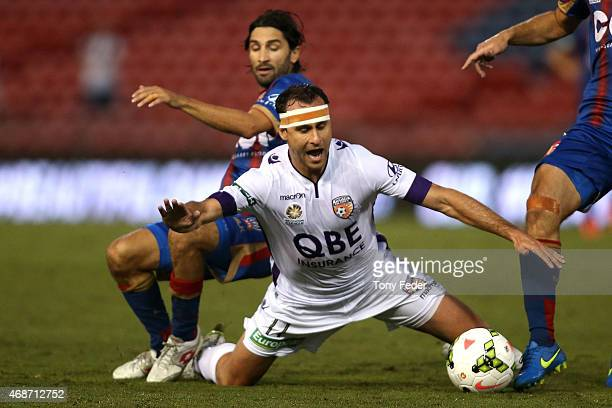 Richard Garcia of the Glory contests the ball with Zenon Caravella of the Jets during the round 24 A-League match between the Newcastle Jets and...