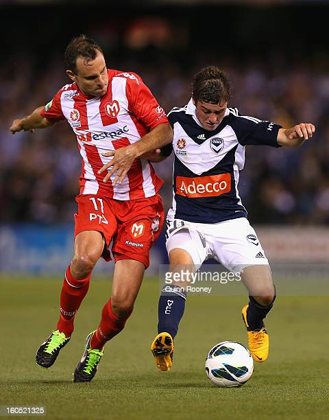 Richard Garcia of the Heart and Marco Rojas of the Victory contest for the ball during the round 19 ALeague match between the Melbourne Victory and...
