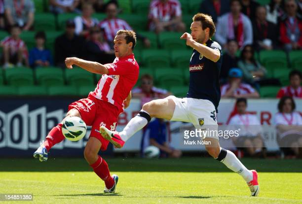 Richard Garcia of the Heart crosses the ball as Joshua Rose of the Mariners defends during the round four A-League match between the Melbourne Heart...