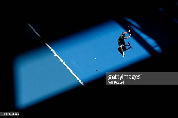 Richard Gasket of France plays a backhand to Dan Evans of Great Britain in the Mens singles match on day four of the 2017 Hopman Cup at Perth Arena...