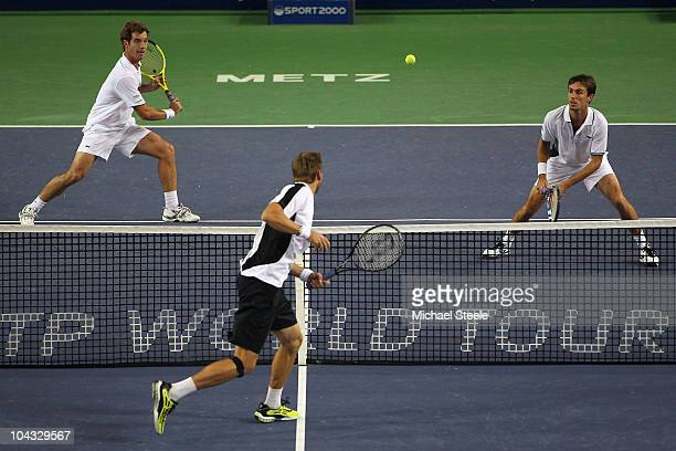 Richard Gasquet and Edouard RogerVasselin of France can only watch as Johan Brunstrom of Sweden hits a volley during day two of the Open de Moselle...
