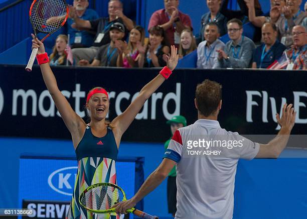 Richard Gasquet and Kristina Mladenovic of France celebrate after defeating Jack Sock and Coco Vandeweghe of the US in the mixed doubles final on day...