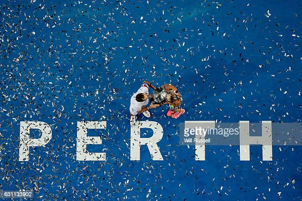 Richard Gasquet and Kristina Mladenovic of France hold kiss the Hopman Trophy after defeating Coco Vandeweghe and Jack Sock of the United States in...