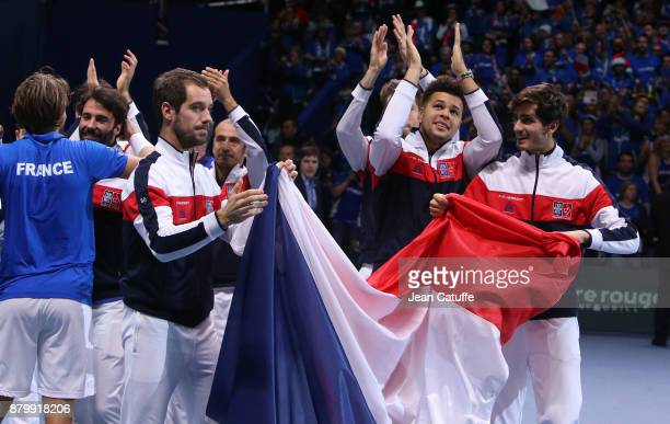 Richard Gasquet JoWilfried Tsonga PierreHughes Herbert of France celebrate winning the Davis Cup during day 3 of the Davis Cup World Group final...