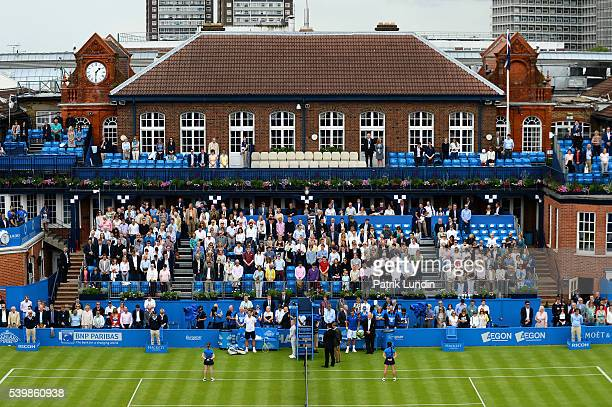 Richard Gasquet of France and Steve Johnson of United States and fans observe one minute silence before start of play for mass shooting in Orlando at...
