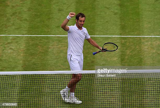 Richard Gasquet of France celebrates at the net after winning his Gentlemens Singles Quarter Final match against Stanislas Wawrinka of Switzerland...