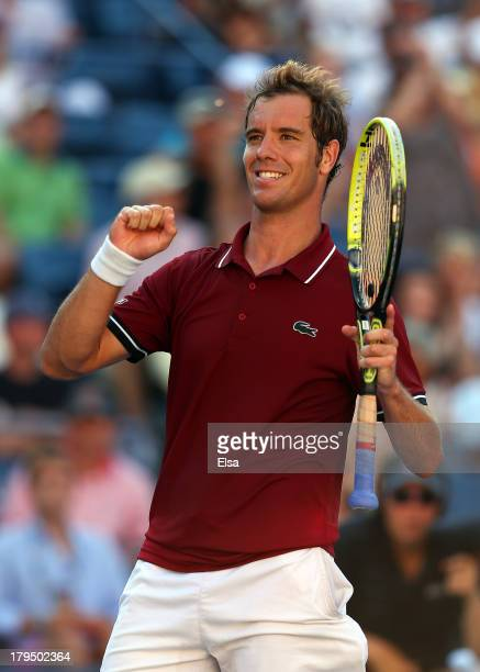 Richard Gasquet of France celebrates match point after his men's singles quarterfinal match against David Ferrer of Spain on Day Ten of the 2013 US...