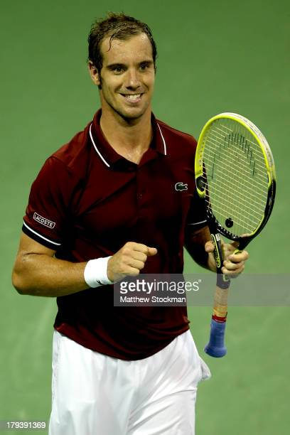 Richard Gasquet of France celebrates match point against Milos Raonic of Canada during their fourth round round men's singles match on Day Eight of...