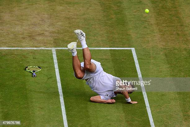 Richard Gasquet of France falls in his Gentlemens Singles Quarter Final match against Stanislas Wawrinka of Switzerland during day nine of the...
