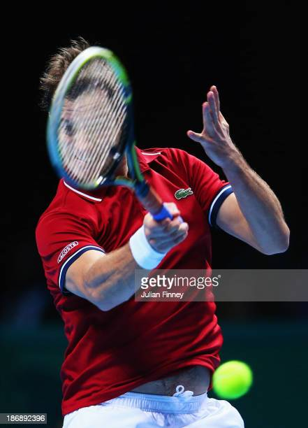 Richard Gasquet of France hits a forehand in his men's singles match against Juan Martin Del Potro of Argentina during day one of the Barclays ATP...