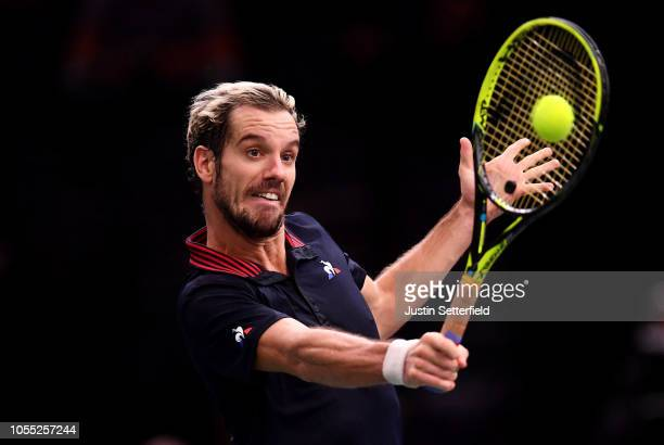 Richard Gasquet of France plays a backhand against Denis Shapovalov of Canada during Day 1 of the Rolex Paris Masters on October 29 2018 in Paris...