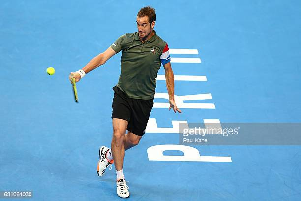 Richard Gasquet of France plays a backhand against Roger Federer of Switzerland in the men's singles match during day six of the 2017 Hopman Cup at...