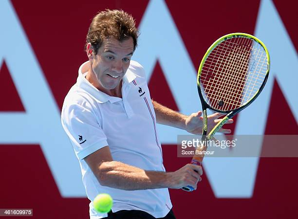 Richard Gasquet of France plays a backhand during his match against Gilles Simon of France during day three of the AAMI Classic at Kooyong on January...