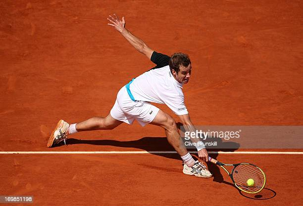 Richard Gasquet of France plays a backhand during his Men's Singles match against Stanislas Wawrinka of Switzerland during day nine of the French...