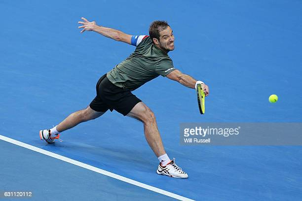 Richard Gasquet of France plays a backhand to Jack Sock of the United States in the mens singles match during the 2017 Hopman Cup Final at Perth...