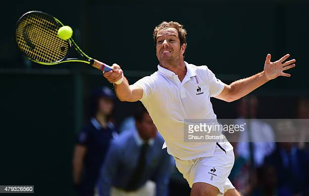 Richard Gasquet of France plays a forehand in his Gentlemen's Singles Third Round match against Grigor Dimitrov of Bulgaria during day five of the...