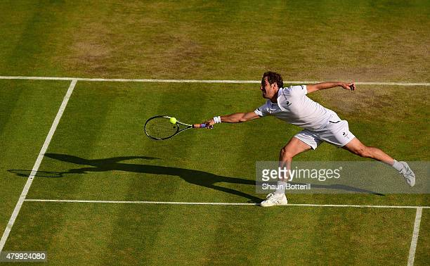 Richard Gasquet of France plays a forehand in his Gentlemens Singles Quarter Final match against Stanislas Wawrinka of Switzerland during day nine of...