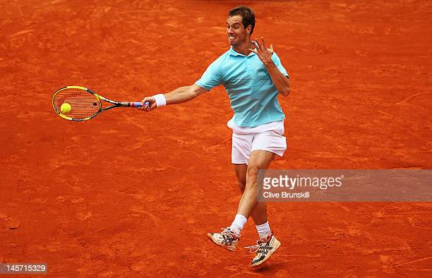 Richard Gasquet of France plays a forehand in his men's singles fourth round match against Andy Murray of Great Britain during day 9 of the French...