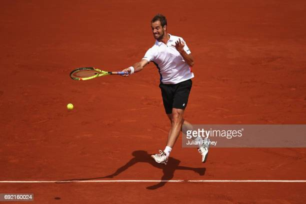 Richard Gasquet of France plays a forehand in his men's singles third round match against Gael Monfils of France during day eight of the French Open...