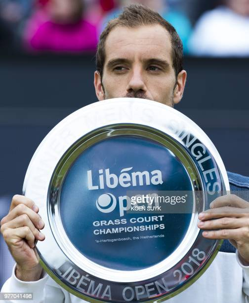 Richard Gasquet of France poses with his trophy after winning the men's final of the Libema Open tennis tournament in Rosmalen The Netherlands on...