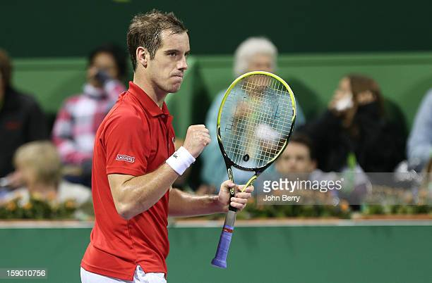 Richard Gasquet of France pumps his fist during the final against Nikolay Davydenko of Russia on day six of the Qatar Open 2013 at the Khalifa...