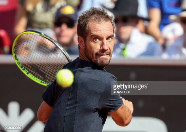 Richard Gasquet of France returns a ball to Henri Laaksonen of Switzerland during their semifinal match at the Swedish Open tennis tournament in...