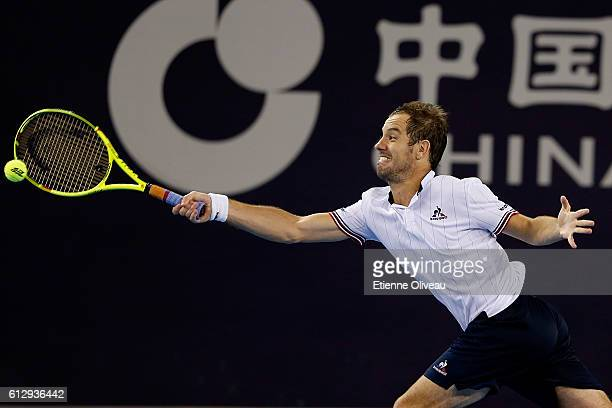 Richard Gasquet of France returns a shot against Pablo Carreno Busta of Spain during the Men's singles second round match on day six of the 2016...