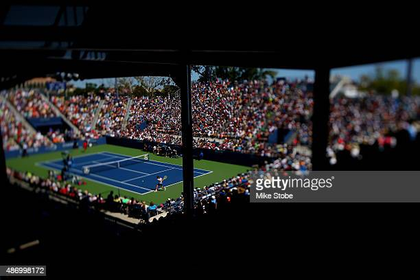 Richard Gasquet of France returns a shot to Bernard Tomic of Australia during their Men's Single round three match on Day Six of the 2015 US Open at...