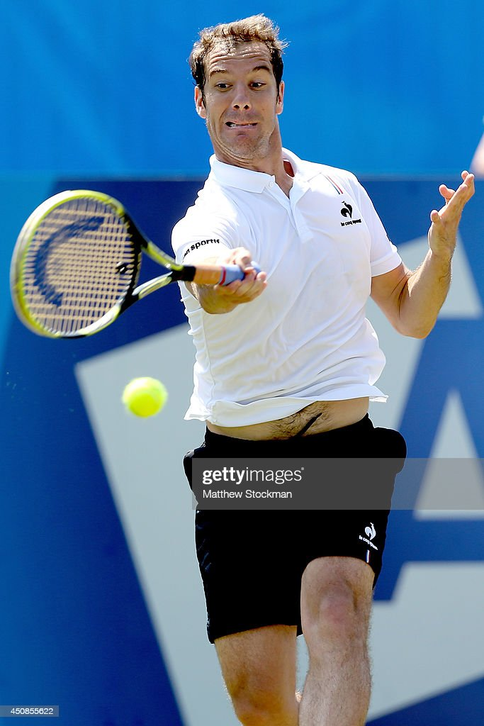 Richard Gasquet of France returns a shot to Martin Klizan of Slovakia during the Aegon International at Devonshire Park on June 19, 2014 in Eastbourne, England.