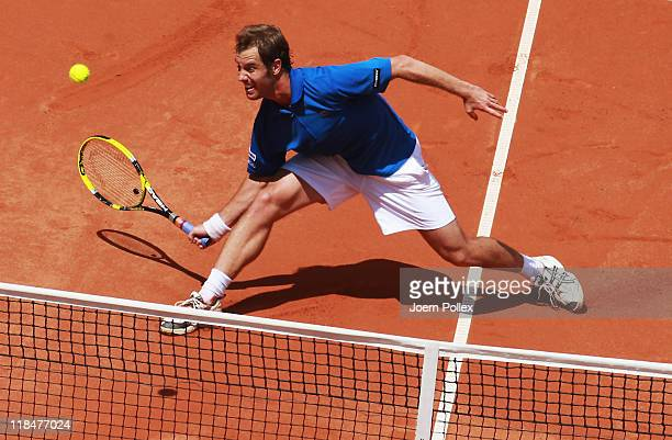 Richard Gasquet of France returns the ball to Florian Mayer of Germany during the quarterfinals match in the Davis Cup World Group at Tennis club...