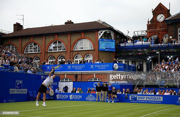Richard Gasquet of France serves during his first round match against Steve Johnson of The USA on day one of the Aegon Championships at Queens Club...
