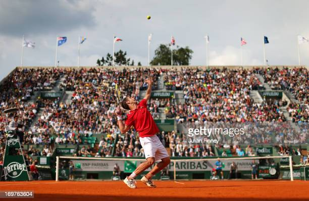 Richard Gasquet of France serves during his Men's Singles match against Nikolay Davydenko of Russian Federation on day seven of the French Open at...