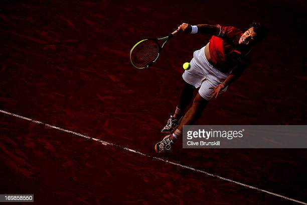 Richard Gasquet of France serves during his Men's Singles match against Stanislas Wawrinka of Switzerland on day nine of the French Open at Roland...
