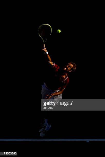 Richard Gasquet of France serves during his men's singles quarter-final match against David Ferrer of Spain on Day Ten of the 2013 US Open at USTA...