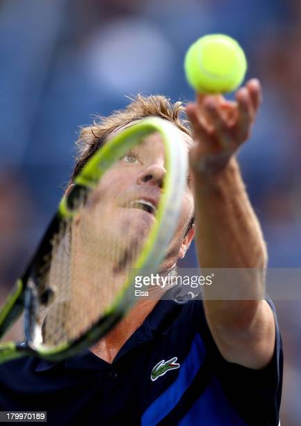 Richard Gasquet of France serves during his men's singles semifinal match against Rafael Nadal of Spain on Day Thirteen of the 2013 US Open at USTA...