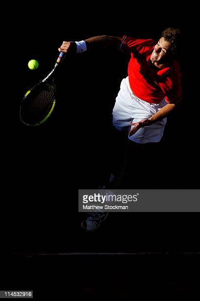 Richard Gasquet of France serves during the men's singles first round match between Richard Gasquet of France and Radek Stepanek of Czech Republic on...