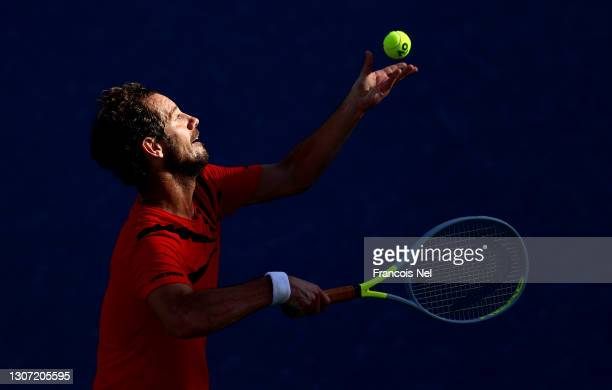 Richard Gasquet of France serves during the Round of 64 Men's Single's match between Richard Gasquet and Marco Cecchinato on Day Nine of the Dubai...
