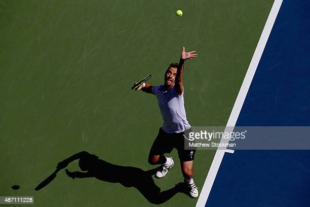 Richard Gasquet of France serves to Bernard Tomic of Australia after defeating him on Day Six of the 2015 US Open at the USTA Billie Jean King...