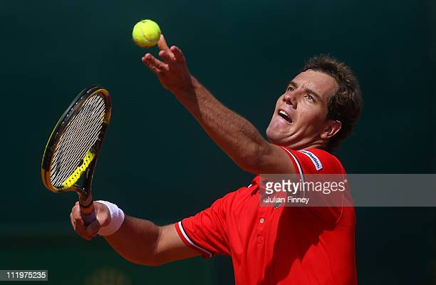 Richard Gasquet of France serves to Denis Istomin of Uzbekistan during Day Two of the ATP Masters Series Tennis at the Monte Carlo Country Club on...