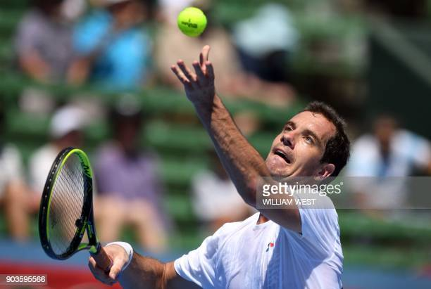 Richard Gasquet of France serves to Matthew Ebden of Australia during their match at the Kooyong Classic tennis tournament in Melbourne on January 11...