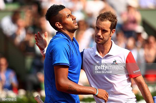 Richard Gasquet of France shakes hands with a dejected Nick Kyrgios of Australia following his victory during the Men's Singles third round match on...